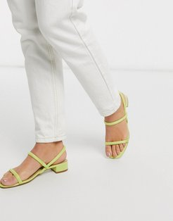 Candidly low heel sandal with tubular strap in yellow