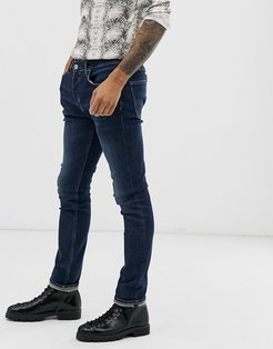 cigarette fit jeans in mid blue wash