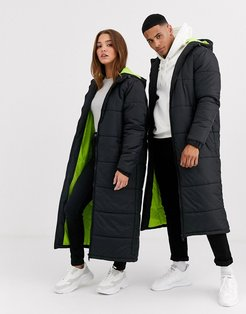 unisex longline puffer in black with neon lining