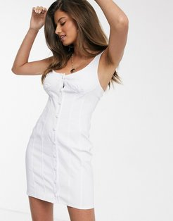 button through cupped mini sundress in white