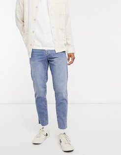 classic rigid jeans in vintage light wash blue with raw hem