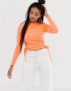 crew neck fitted top with ruched sides-Orange