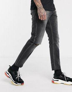 cropped rigid slim jeans in washed black with raw hem and knee rip