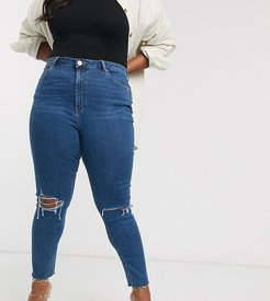 ASOS DESIGN Curve Ridley high waist skinny jeans in bright midwash blue with rips and raw hem