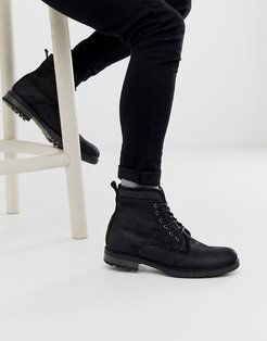 lace up work boots in black leather with faux shearling lining