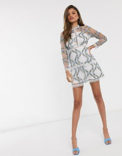 long sleeve tiered mini dress in blue embroidered floral mesh in white base-Multi