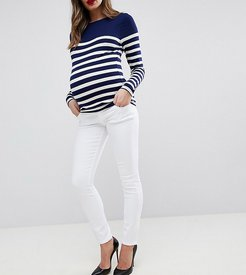 ASOS DESIGN Maternity Ridley high waisted skinny jeans in optic white with under the bump waistband