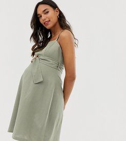 ASOS DESIGN Maternity square neck linen mini sundress with contrast stitch and buckle-Green