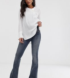 ASOS DESIGN Maternity super low rise flare jeans in dark stone wash blue with over the bump waistband