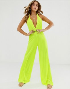 neon yellow plunge neck slinky jersey beach jumpsuit with twist back