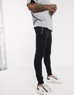 organic super skinny sweatpants in black with silver zip pockets