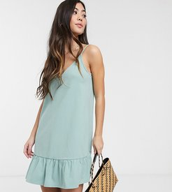 ASOS DESIGN Petite Exclusive v front mini dress with pep hem in sage-Green