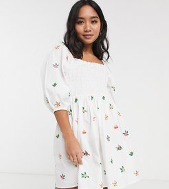 ASOS DESIGN Petite shirred mini dress with all over embroidery in white