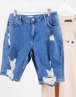 skinny denim shorts in mid blue with rips