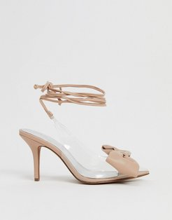 Sylvie tie leg mid-heels with bow in beige and clear