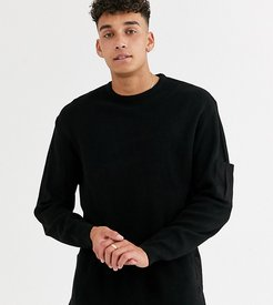 tall knitted ribbed sweater with woven panels in black