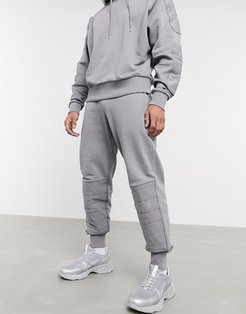 two-piece oversized sweatpants with biker panels in gray