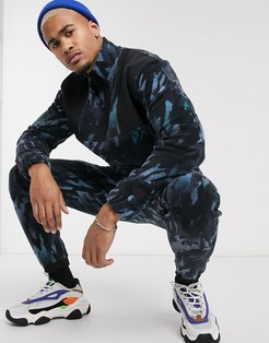 two-piece slim sweatpants with camo fleece and nylon panels-Blue