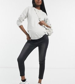 Maternity over the bump ankle grazer skinny jean with raw hem and removable bump band-Black