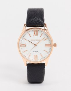 watch with black strap and rose gold dial