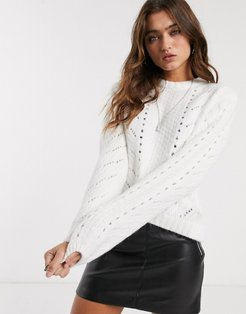 cable knitted sweater in cream