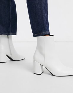 patent boot with block heel in white