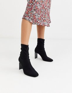setback heeled boots in black