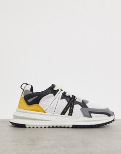 sneakers in white with black and orange detailing