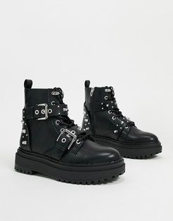 stud and buckle detail boots in black
