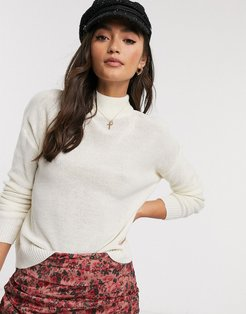high neck sweater in ivory-White