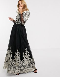 premium lace maxi dress in black and gold