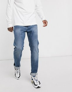 ED80 slim fit jeans in washed blue denim