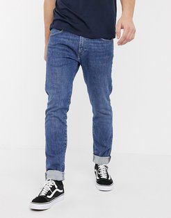 ED85 skinny fit jeans in washed blue denim