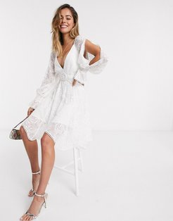 belted mini dress with cutout details in white
