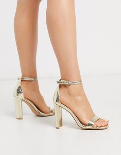 barely there heeled sandal in metallic gold snake