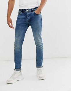 slim jeans in mid wash blue