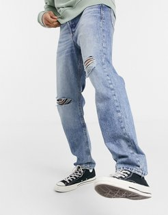 Intelligence Chris loose fit jeans with rips in light blue