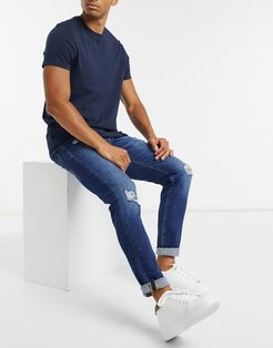 Intelligence slim fit jean with rips in mid blue