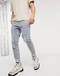 Liqour N Poker slim fit jeans with knee abrasions in light blue wash