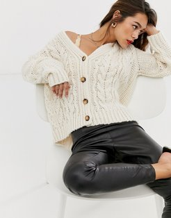 button front oversized cable knit cardigan in cream-Beige