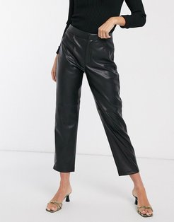 faux leather paneled pants in black