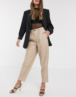 faux leather slouchy pants in beige