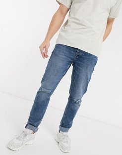 slim fit distressed jeans in light blue