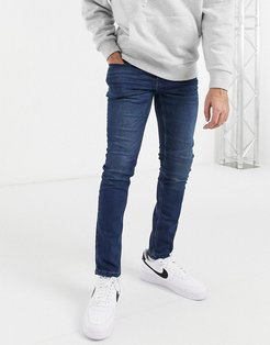 slim fit jeans in mid blue