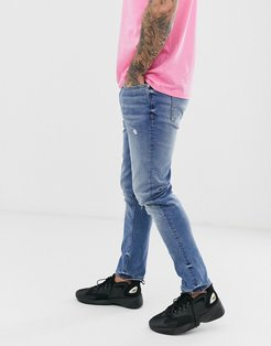 recycled slim denim jeans in mid blue