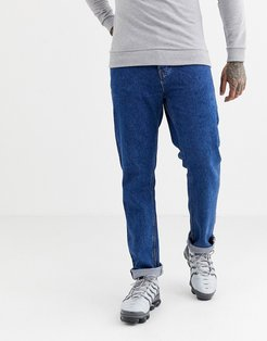 relaxed fit jeans in mid wash blue