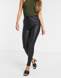 coated skinny jeans with high rise in black