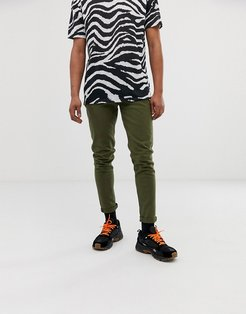 Cone slim tapered jeans in green
