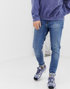 Cone slim tapered jeans in marfa blue