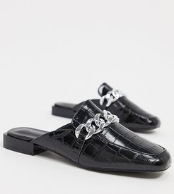 Exclusive Trace vegan blackless mules with chunky chain in black croc